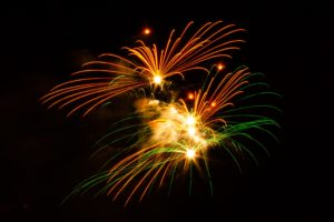 Fun orange, green, and gold Disneyland fireworks