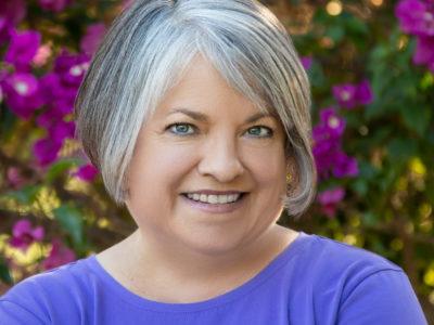 Business portrait Julie Diebolt Price grin bougainvillea