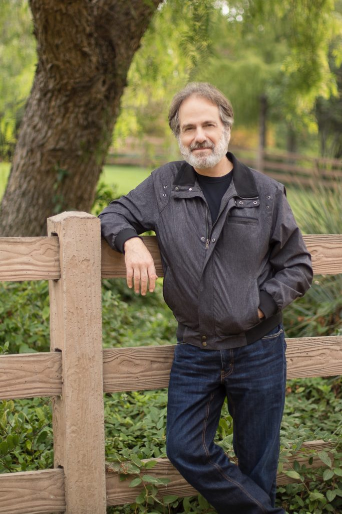 photography - Business portrait environmental author relaxed leaning on fence