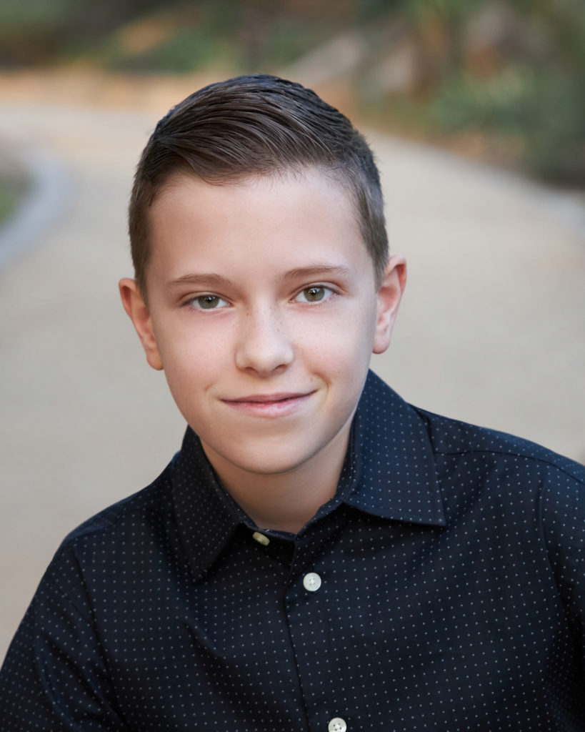 Headshot boy with polka dot shirt