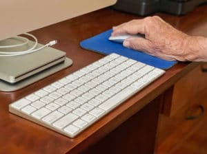Use of technology keyboard, computer, mouse, mouse pad, man's hand